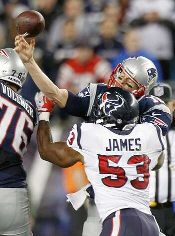 New England Patriots quarterback Tom Brady (12) gets off a pass as he is hit by Houston Texans inside linebacker Bradie James (53) during the second quarter. (Brett Coomer / Houston Chronicle)