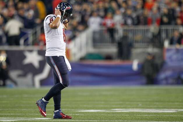 Texans quarterback Matt Schaub walks off the field after a defensive stop during the second quarter. (Brett Coomer / Houston Chronicle)