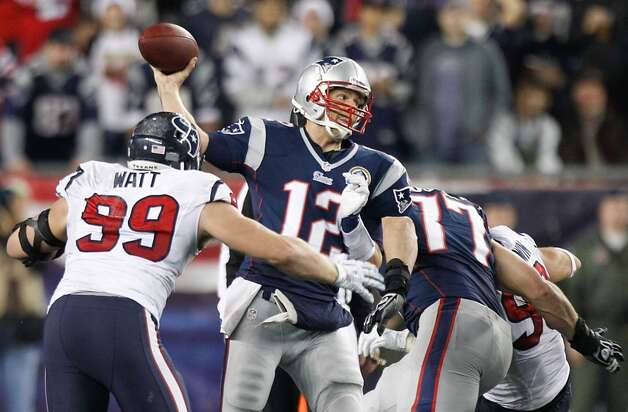 Patriots quarterback Tom Brady (12) gets off a pass as Texans defensive end J.J. Watt (99) applies pressure during the second quarter. (Brett Coomer / Houston Chronicle)
