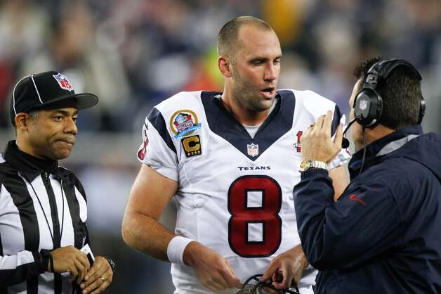 Texans quarterback Matt Schaub (8) confers with head coach Gary Kubiak during the second quarter. (Brett Coomer / Houston Chronicle)