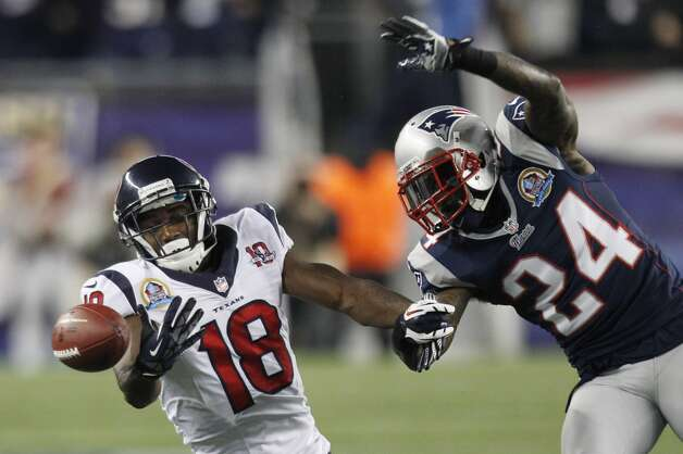 Texans wide receiver Lestar Jean (18) can't hold on to a pass as New England Patriots cornerback Kyle Arrington (24) defends during the first quarter. (Brett Coomer / Houston Chronicle)