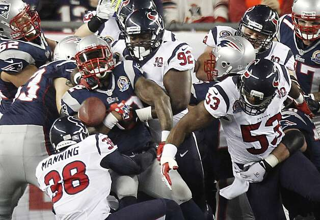 Patriots running back Stevan Ridley (22) fumbles as Texans free safety Danieal Manning (38), nose tackle Earl Mitchell (92) and inside linebacker Bradie James (53) defend during the first quarter. (Brett Coomer / Houston Chronicle)