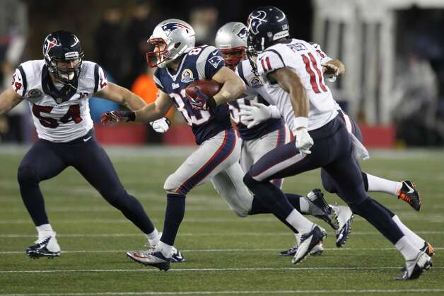 Patriots wide receiver Wes Welker (83) splits the defense between the Texans Barrett Ruud (54) and DeVier Posey (11). (Brett Coomer / Houston Chronicle)