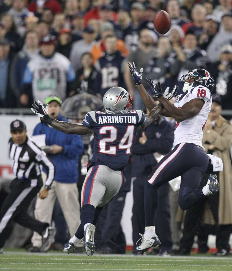 Texans wide receiver Lestar Jean (18) can't hold on to a pass as New England Patriots cornerback Kyle Arrington (24) defends. (Nick de la Torre / Houston Chronicle)