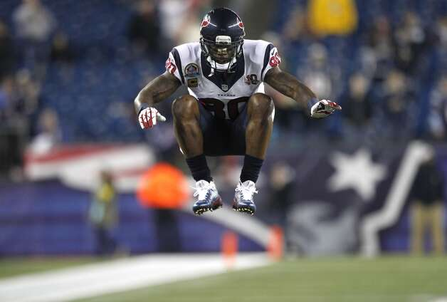 Texans wide receiver Andre Johnson warms up before a Monday Night Football game against the New England Patriots at Gillette Stadium. (Brett Coomer / Houston Chronicle)