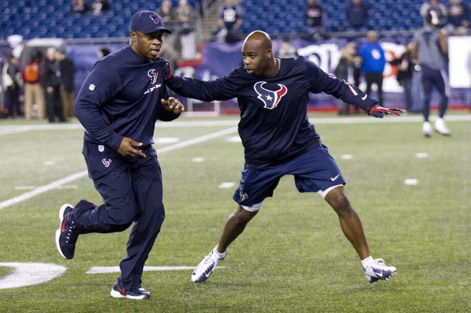 Texans defensive backs coach Vance Joseph, left, works with cornerback Johnathan Joseph  before a Monday Night Football game against the New England Patriots. (Brett Coomer / Houston Chronicle)