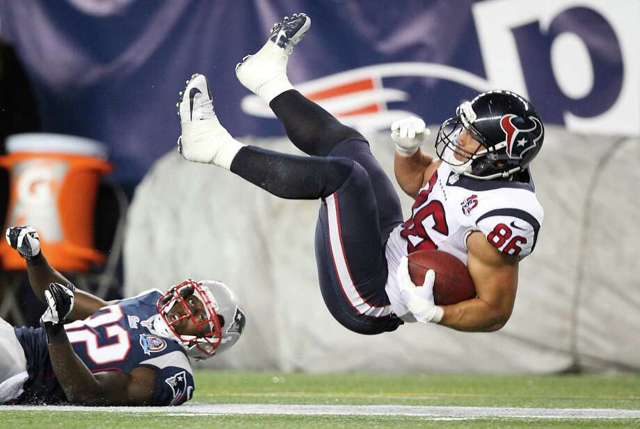 Texans fullback James Casey (86) is upended by Patriots free safety Devin McCourty (32) during the third quarter. Photo: Nick De La Torre, Houston Chronicle / © 2012  Houston Chronicle