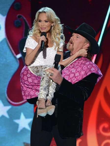 Hosts Kristin Chenoweth (L) and Trace Adkins speak onstage.