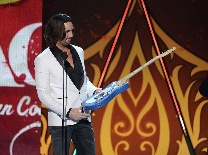Musician Jake Owen accepts the Breakthrough Artist of the Year award onstage.