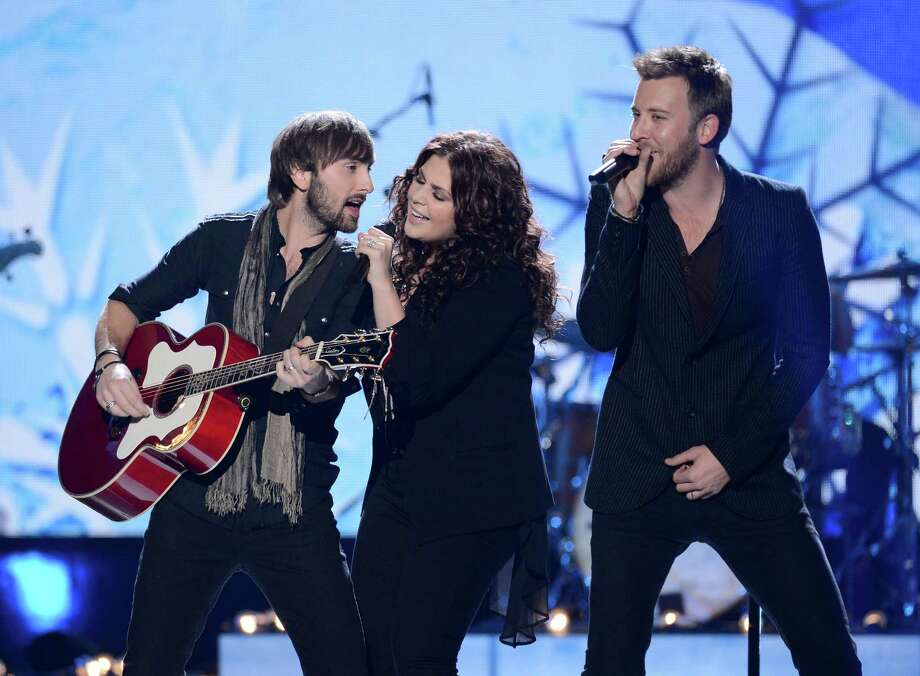 (L-R) Musicians Dave Haywood, Hillary Scott, and Charles Kelley of Lady Antebellum perform onstage. Photo: Mark Davis, Getty Images / 2012 Getty Images