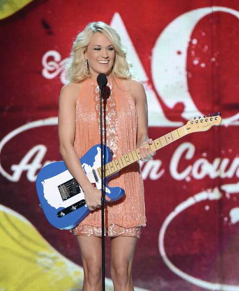Singer Carrie Underwood accepts the Female Artist of the Year award onstage.