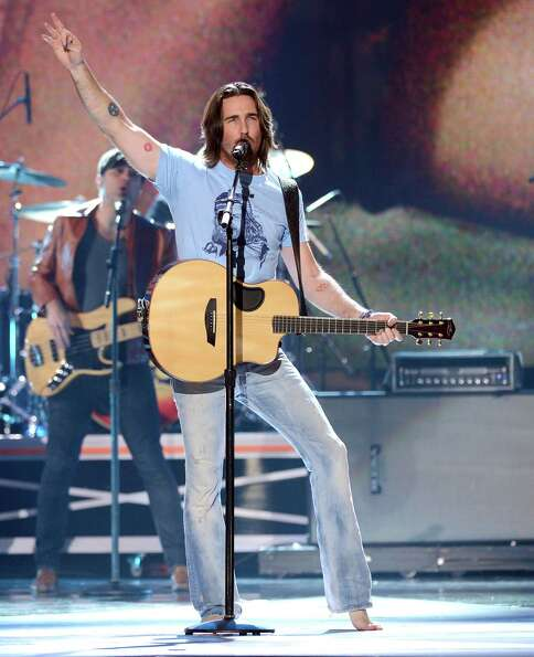 Musician Jake Owen performs onstage.