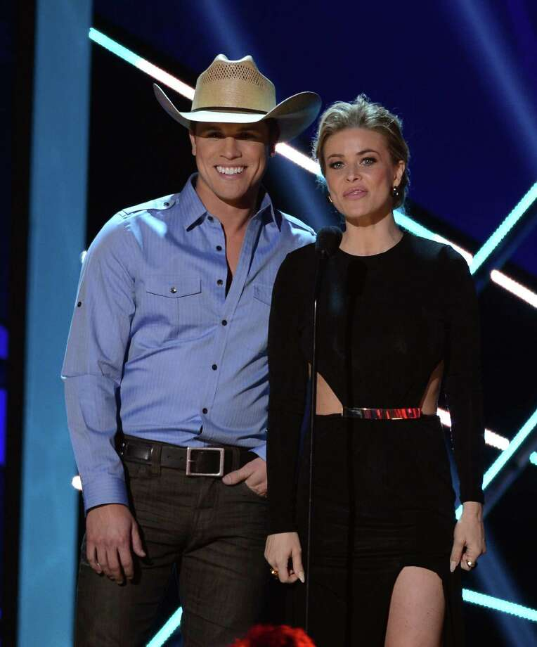 (L-R) Presenters Dustin Lynch and Carmen Electra speak onstage. Photo: Mark Davis, Getty Images / 2012 Getty Images