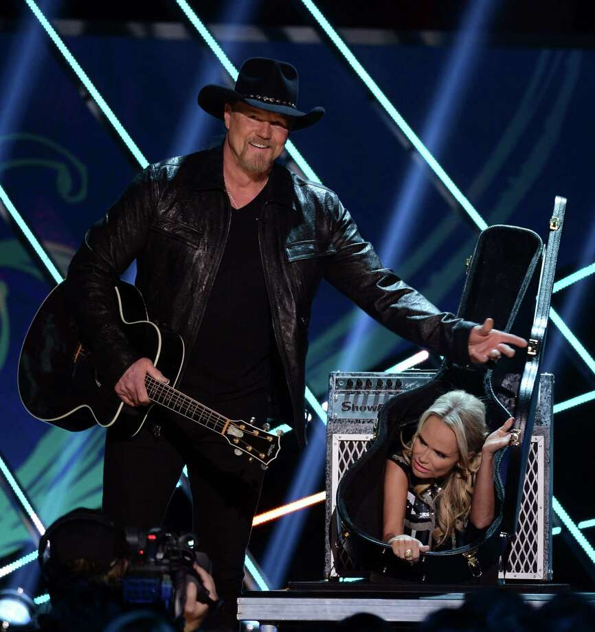 Hosts Trace Adkins (L) and Kristin Chenoweth speak onstage. Photo: Mark Davis, Getty Images / 2012 Getty Images