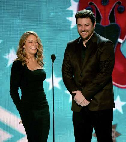 Presenters LeAnn Rimes and Chris Young speak onstage. Photo: Mark Davis, Getty Images / 2012 Getty Images