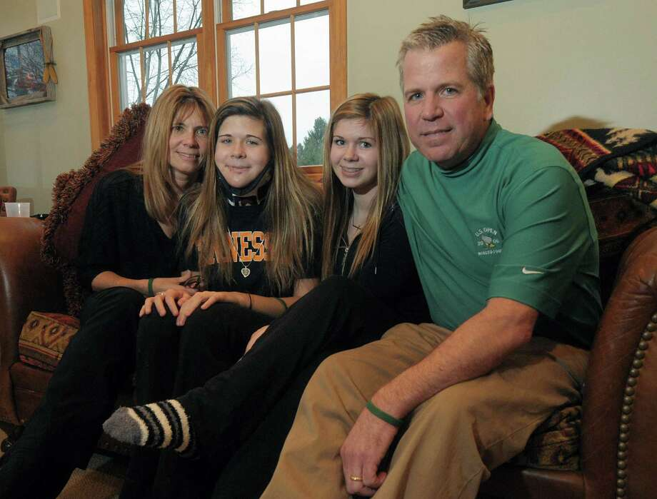 The Wind family, from left, Dawn, her daughters Bailey and Nikki and her husband Bobby, pose for a photograph at their home on Monday, Dec. 10, 2012 in Latham, NY.  Bailey was in the traffic accident which took the lives of her boyfriend, Chris Stewart, and their friend Deanna Rivers.  (Paul Buckowski / Times Union) Photo: Paul Buckowski