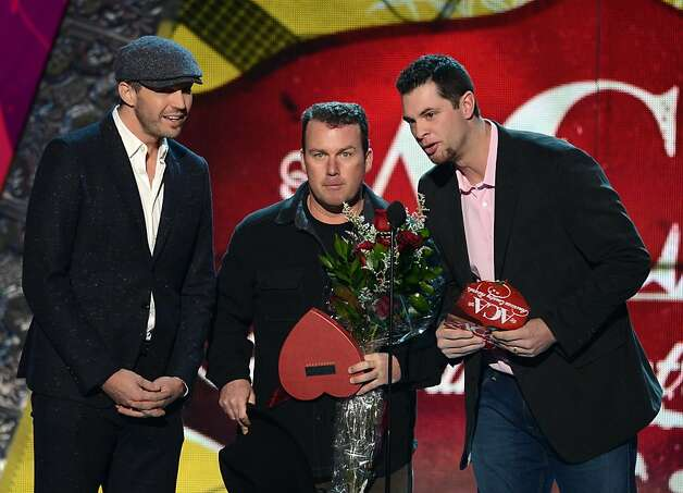Presenters (L-R) Barry Zito, Rodney Carrington and Brandon Belt speak onstage. Photo: Mark Davis, Getty Images