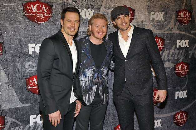 From left, Jimi Westbrook, Phillip Sweet of Little Big Town and San Francisco Giants pitcher Barry Zito arrive. Photo: Jeff Bottari, Associated Press