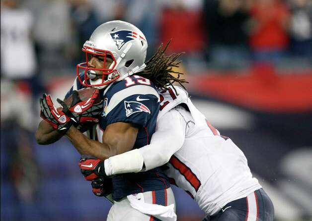 New England Patriots wide receiver Donte' Stallworth (19) drags Houston Texans defensive back Quintin Demps, right, into the end zone for a touchdown after a catch and run during the third quarter of an NFL football game in Foxborough, Mass., Monday, Dec. 10, 2012.  (AP Photo/Stephan Savoia) Photo: Stephan Savoia, Associated Press / AP