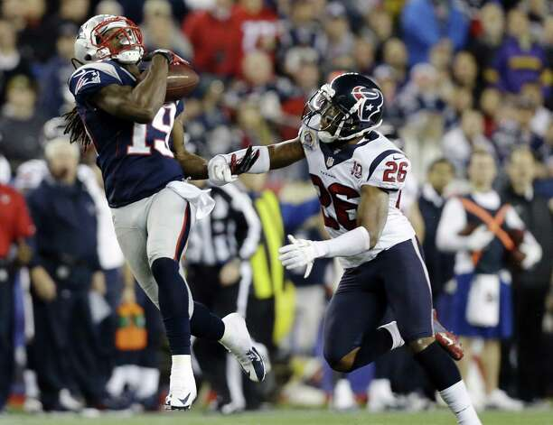 New England Patriots wide receiver Donte' Stallworth (19) catches a pass in front of Houston Texans defensive back Brandon Harris (26) before running it in for a touchdown during the third quarter of an NFL football game in Foxborough, Mass., Monday, Dec. 10, 2012. (AP Photo/Elise Amendola) Photo: Elise Amendola, Associated Press / AP
