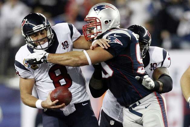 Houston Texans quarterback Matt Schaub (8) is sacked by New England Patriots defensive end Rob Ninkovich (50) during the first quarter of an NFL football game in Foxborough, Mass., Monday, Dec. 10, 2012. (AP Photo/Stephan Savoia) Photo: Stephan Savoia, Associated Press / AP