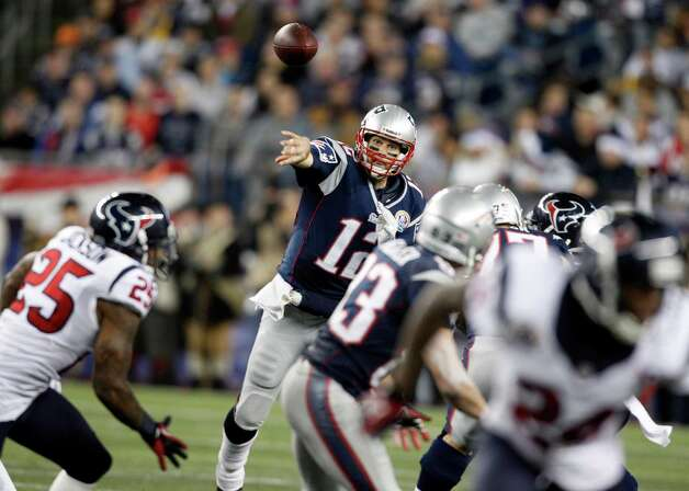 New England Patriots quarterback Tom Brady (12) passes against the Houston Texans during the third quarter of an NFL football game in Foxborough, Mass., Monday, Dec. 10, 2012. (AP Photo/Stephan Savoia) Photo: Stephan Savoia, Associated Press / AP