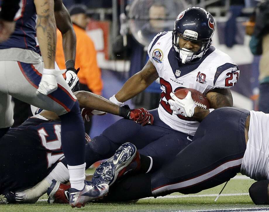 Houston Texans running back Arian Foster (23) scores a touchdown in front of New England Patriots outside linebacker Jerod Mayo (51) during the third quarter of an NFL football game in Foxborough, Mass., Monday, Dec. 10, 2012. The Patriots won 42-14. (AP Photo/Elise Amendola) Photo: Elise Amendola, Associated Press / AP