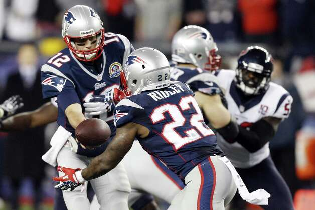 New England Patriots quarterback Tom Brady (12) hands off to running back Stevan Ridley (22) during the first quarter of an NFL football game against the Houston Texans in Foxborough, Mass., Monday, Dec. 10, 2012. (AP Photo/Stephan Savoia) Photo: Stephan Savoia, Associated Press / AP