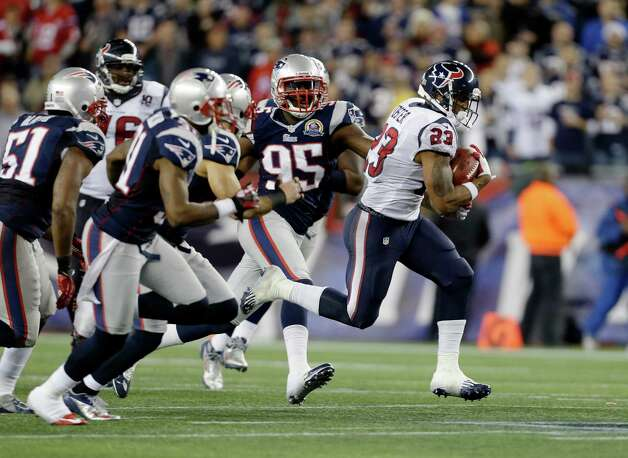 Houston Texans running back Arian Foster (23) runs from New England Patriots defensive end Chandler Jones (95) and his teammates during the second quarter of an NFL football game in Foxborough, Mass., Monday, Dec. 10, 2012. (AP Photo/Elise Amendola) Photo: Elise Amendola, Associated Press / AP