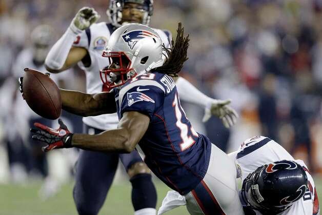 New England Patriots wide receiver Donte' Stallworth (19) dives into the end zone while dragging Houston Texans defensive back Quintin Demps, right, for a touchdown after a catch and run during the third quarter of an NFL football game in Foxborough, Mass., Monday, Dec. 10, 2012. (AP Photo/Elise Amendola) Photo: Elise Amendola, Associated Press / AP