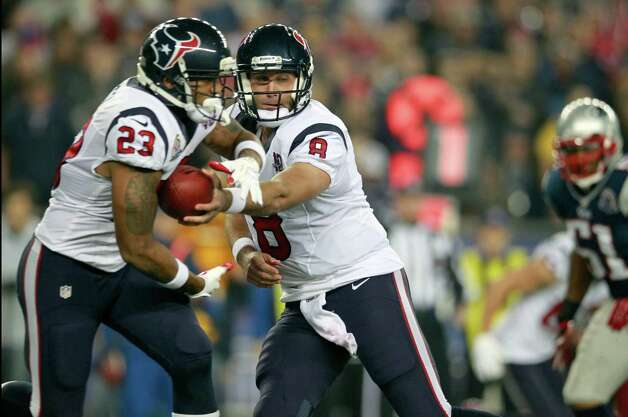 Houston Texans quarterback Matt Schaub (8) hands off to running back Arian Foster (23) during the first quarter of an NFL football game against the New England Patriots in Foxborough, Mass., Monday, Dec. 10, 2012. (AP Photo/Steven Senne) Photo: Steven Senne, Associated Press / AP