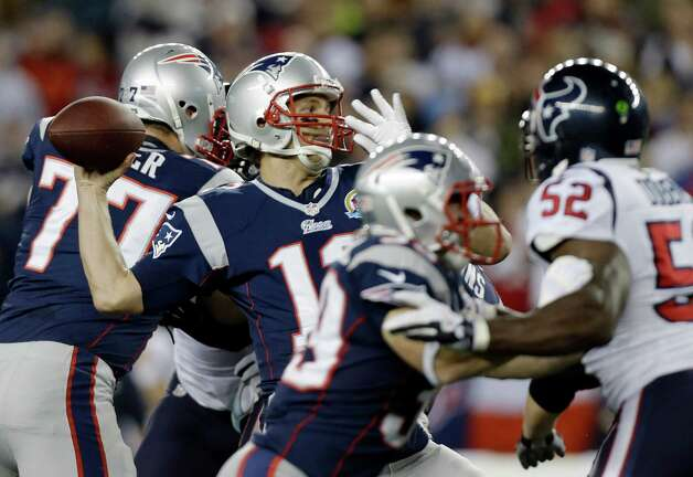 New England Patriots quarterback Tom Brady (12) passes over Houston Texans inside linebacker Tim Dobbins (52) during the first quarter of an NFL football game in Foxborough, Mass., Monday, Dec. 10, 2012. (AP Photo/Elise Amendola) Photo: Elise Amendola, Associated Press / AP