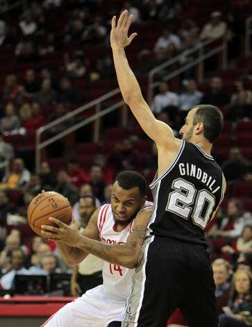 Dec. 10: Spurs 134, Rockets 126 (OT)Rockets guard Daequan Cook is pressured by Spurs guard Manu Ginobili. (James Nielsen / Houston Chronicle)