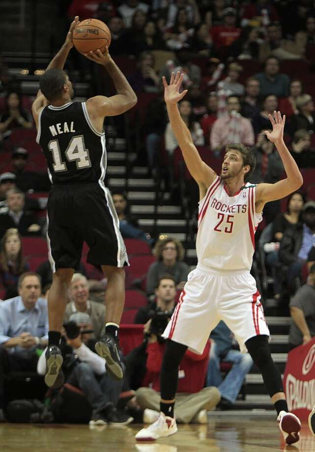 Spurs guard Gary Neal attempts a shot over Rockets forward Chandler Parsons. (James Nielsen / Houston Chronicle)
