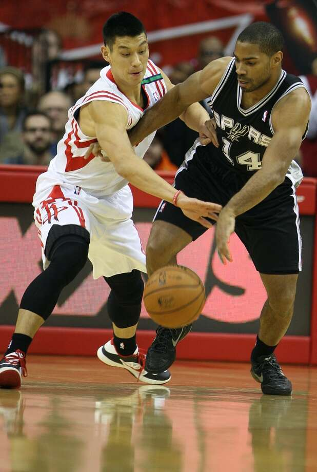 Rockets point guard Jeremy Lin defends Spurs guard Gary Neal. (James Nielsen / Houston Chronicle)