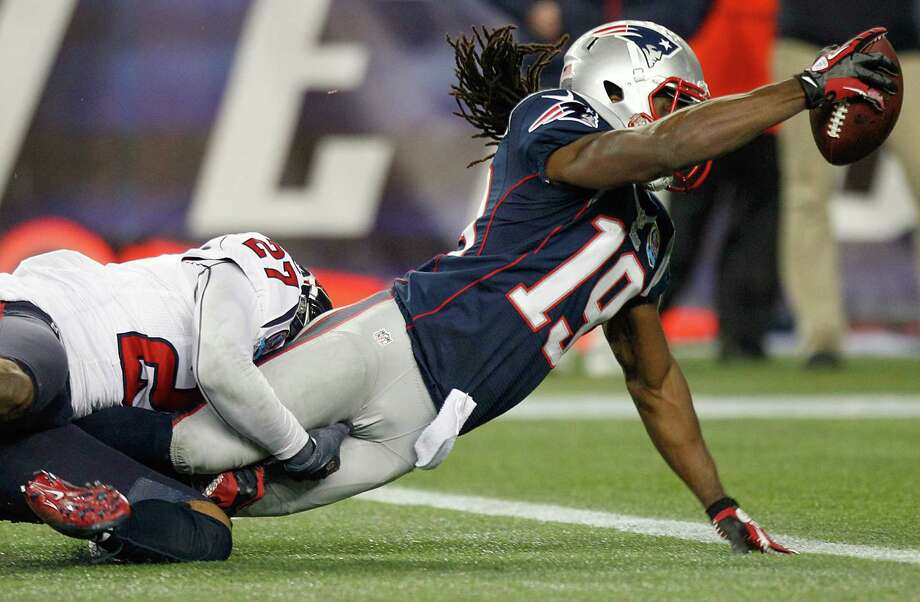 Patriots wide receiver Donte' Stallworth (19) dives over the goal line as he is tackled by Houston Texans defensive back Quintin Demps (27) for a touchdown during the second half. Photo: Brett Coomer, Houston Chronicle / © 2012  Houston Chronicle