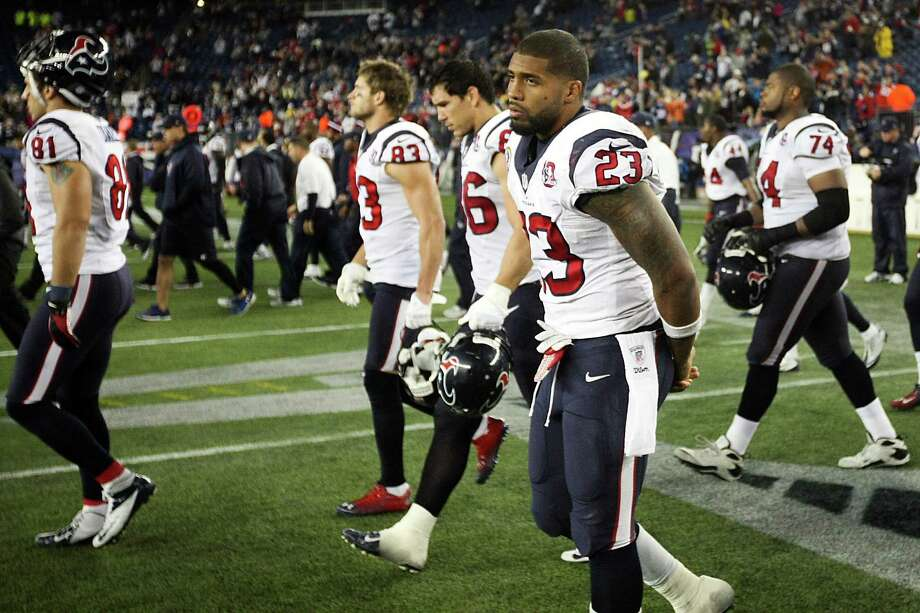Texans running back Arian Foster (23) walks off the field following a loss to the New England Patriots. Photo: Nick De La Torre, Houston Chronicle / © 2012  Houston Chronicle