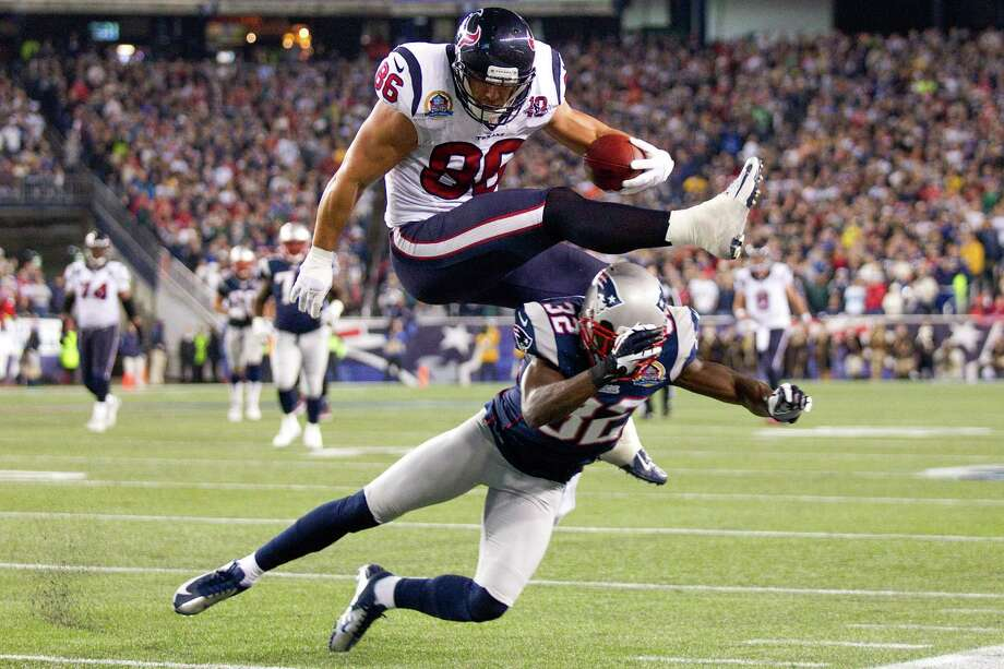 Texans fullback James Casey (86) is stopped short of the goal line by New England Patriots free safety Devin McCourty (32) during the third quarter. Photo: Brett Coomer, Houston Chronicle / © 2012  Houston Chronicle