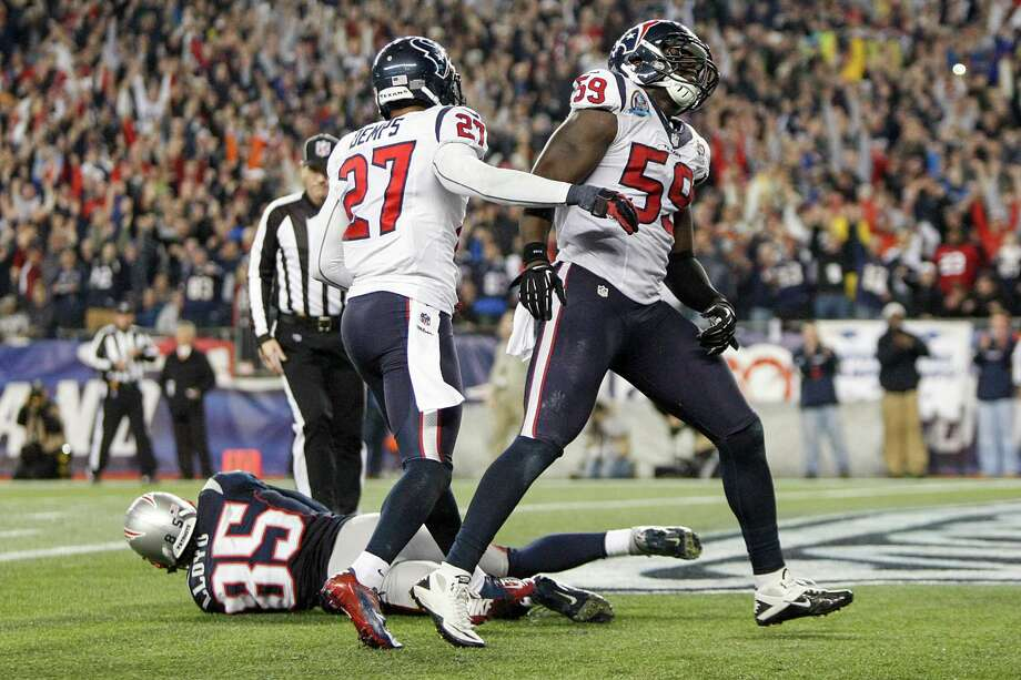Texans outside linebacker Whitney Mercilus (59) reacts after Patriots wide receiver Brandon Lloyd (85) recovered a fumble by running back Danny Woodhead in the end zone for a touchdown. Photo: Nick De La Torre, Houston Chronicle / © 2012  Houston Chronicle