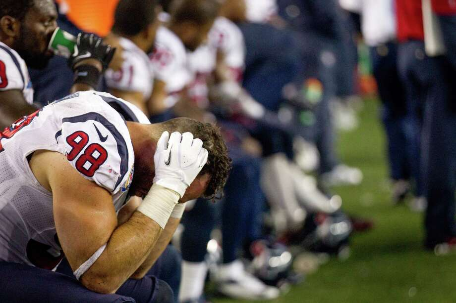 Texans outside linebacker Connor Barwin (98) sits on the bench during the fourth quarter of loss to the New England Patriots. Photo: Brett Coomer, Houston Chronicle / © 2012  Houston Chronicle