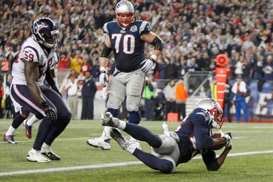 Patriots wide receiver Brandon Lloyd (85) recovers a fumble by running back Danny Woodhead in the end zone for a touchdown as Texans outside linebacker Whitney Mercilus (59) looks on during the fourth quarter. (Nick de la Torre / Houston Chronicle)