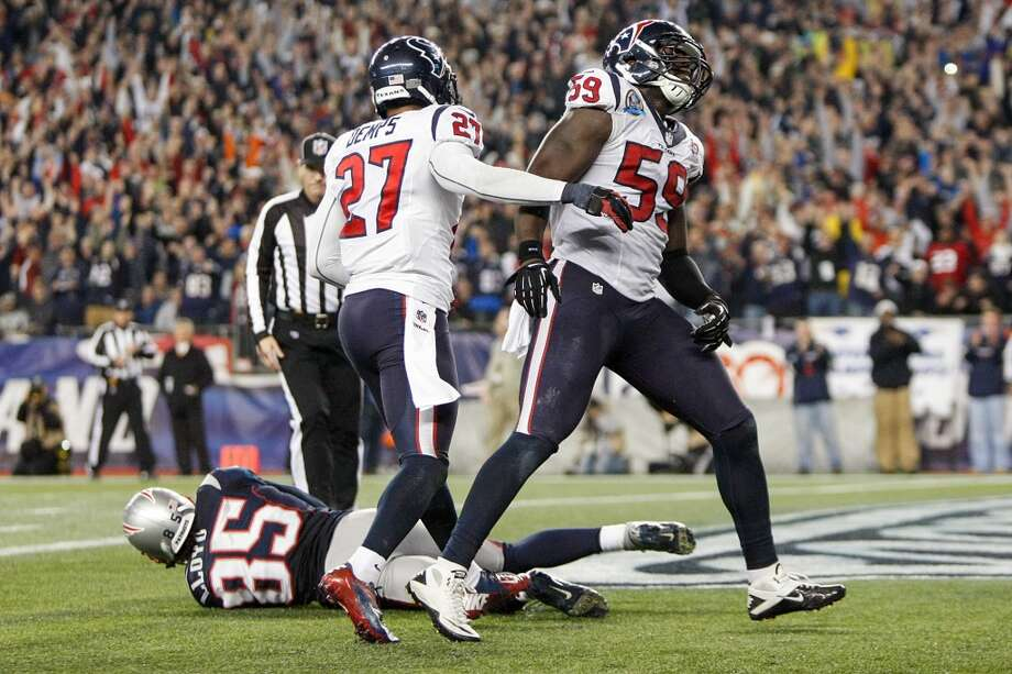 Texans outside linebacker Whitney Mercilus (59) reacts after Patriots wide receiver Brandon Lloyd (85) recovered a fumble by running back Danny Woodhead in the end zone for a touchdown. (Nick de la Torre / Houston Chronicle)