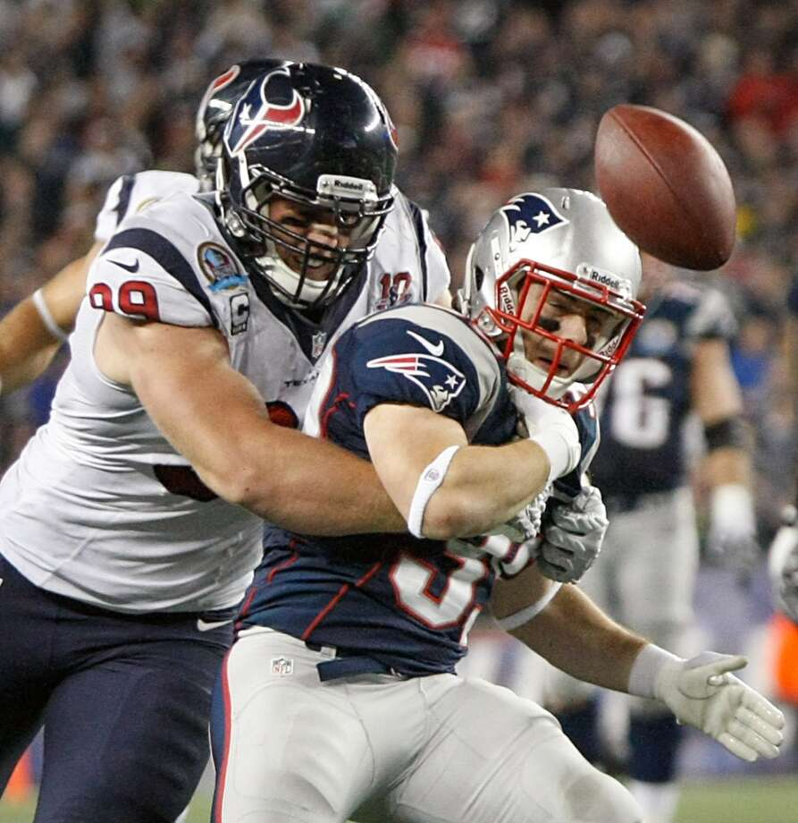Houston Texans defensive end J.J. Watt (99) forces a fumble by New England Patriots running back Danny Woodhead (39) near the goal line during fourth quarter. (Nick de la Torre / Houston Chronicle)
