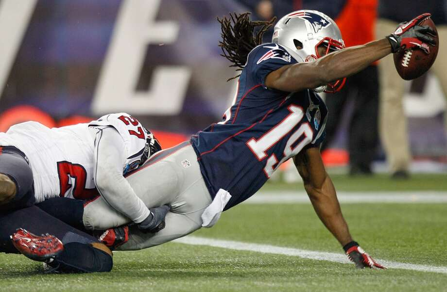 Patriots wide receiver Donte' Stallworth (19) dives over the goal line as he is tackled by Houston Texans defensive back Quintin Demps (27) for a touchdown during the second half. (Brett Coomer / Houston Chronicle)