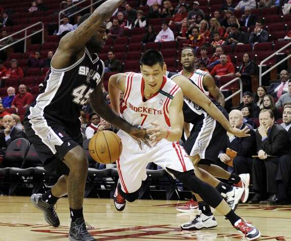 Houston Rockets' Jeremy Lin (7) tries to drives the ball around San Antonio Spurs' DeJuan Blair (45) in the first half of an NBA basketball game, Monday, Dec. 10, 2012, in Houston. (AP Photo/Pat Sullivan) (Associated Press)