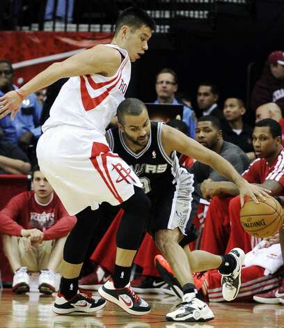 San Antonio Spurs' Tony Parker, right, pushes against Houston Rockets' Jeremy Lin in the first half of an NBA basketball game, Monday, Dec. 10, 2012, in Houston. (AP Photo/Pat Sullivan) (Associated Press)