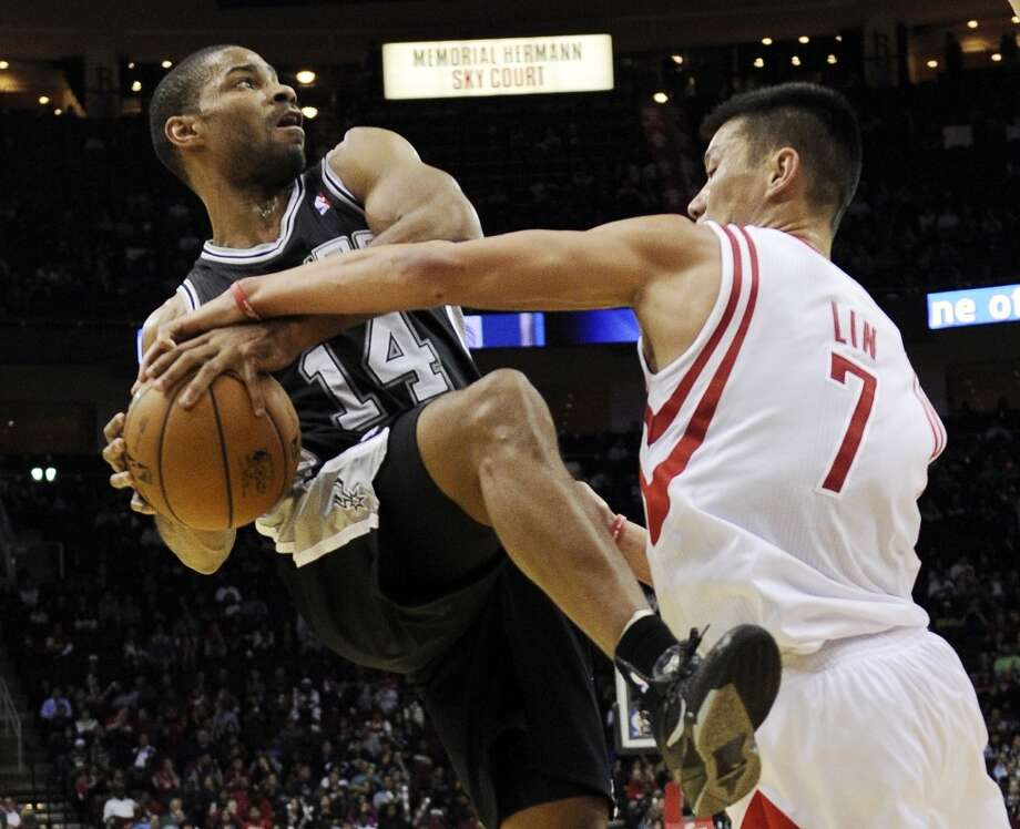 Houston Rockets' Jeremy Lin (7) tries to knock the ball away from San Antonio Spurs' Gary Neal (14) in the second half of an NBA basketball game Monday, Dec. 10, 2012, in Houston. The Spurs won in overtime 134-126. (AP Photo/Pat Sullivan) (Associated Press)