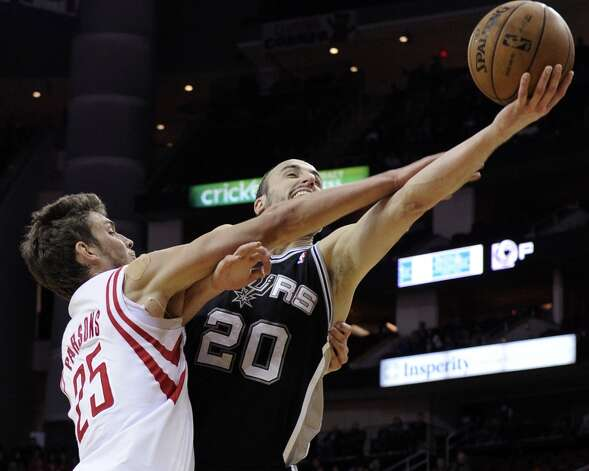 San Antonio Spurs' Manu Ginobili (20) is fouled by Houston Rockets' Chandler Parsons (25) in overtime of an NBA basketball game, Monday, Dec. 10, 2012, in Houston. The Spurs won 134-126. (AP Photo/Pat Sullivan) (Associated Press)