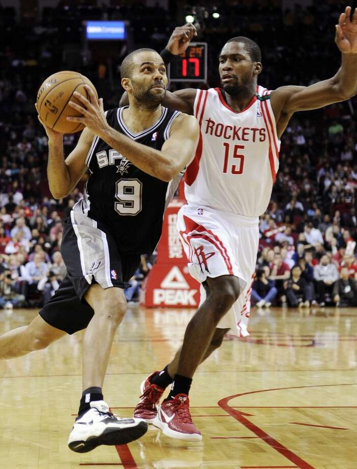 San Antonio Spurs' Tony Parker (9) drives past Houston Rockets' Toney Douglas (15) in the second half of an NBA basketball game, Monday, Dec. 10, 2012, in Houston. The Spurs won in overtime 134-126. (AP Photo/Pat Sullivan) (Associated Press)