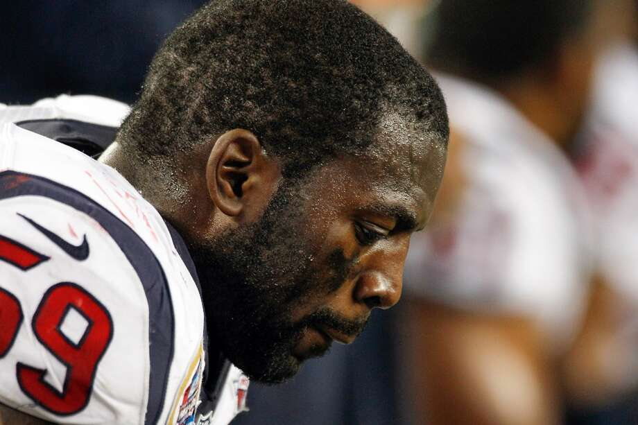 Texans linebacker Whitney Mercilus sits on the bench after the Texans gave up a touchdown to the Patriots during the second half. (Brett Coomer / Houston Chronicle)